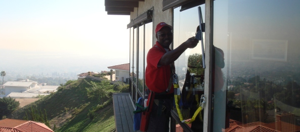 Josh uses a Harness and Lanyard to safely clean windows