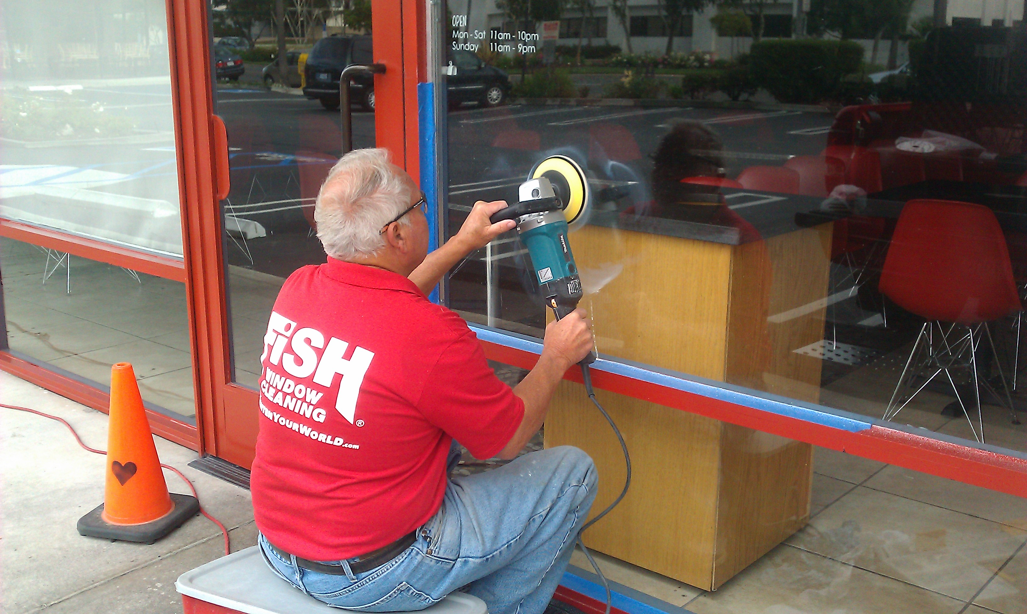 Fish window cleaning completes scratched glass restoration for Fish window cleaning