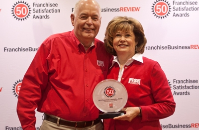 Mike and Linda receive the Franchise Business Review Top 50 award